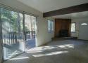 Living room with Sliding Glass Door to Deck